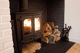 Cosy fire at Holyrood Cottage
