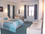 A guest bedroom at Pentland Lodge House